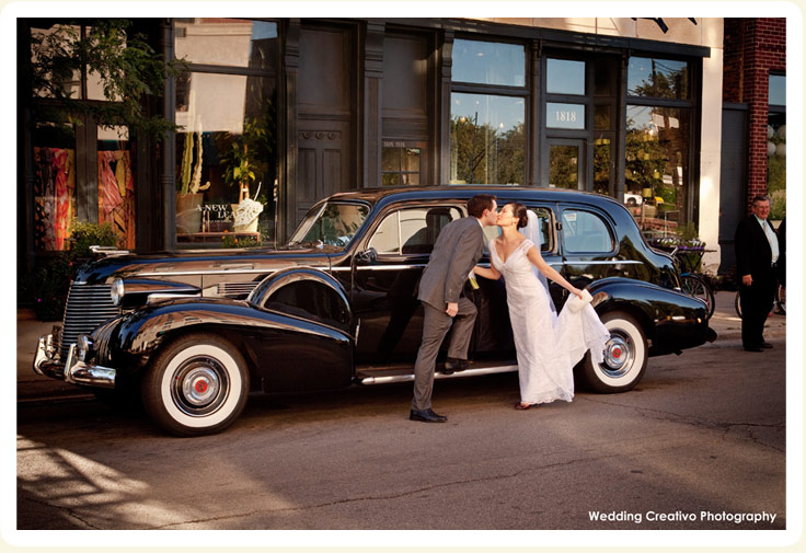 exterior photo of Luxury 1940 black cadillac photo showing bride and groom