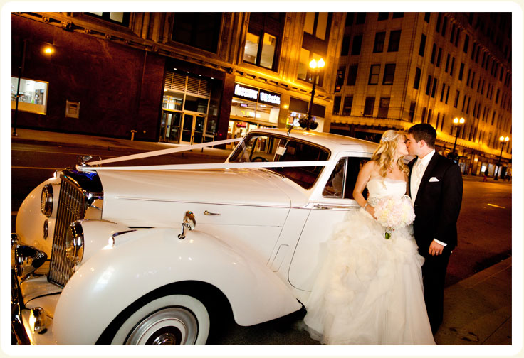 Post Reception 1954 white Bentley rental car showing bride and groom downtown Chicago