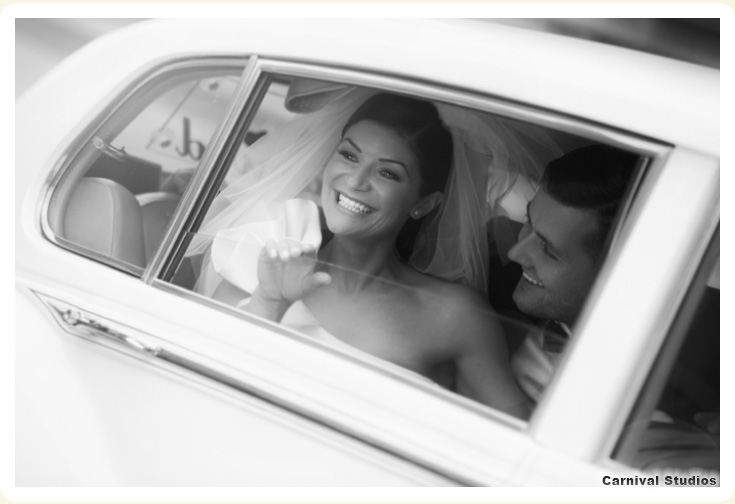 photo of Bride and Groom shown in their 1962 Rolls Royce rental Silver cloud