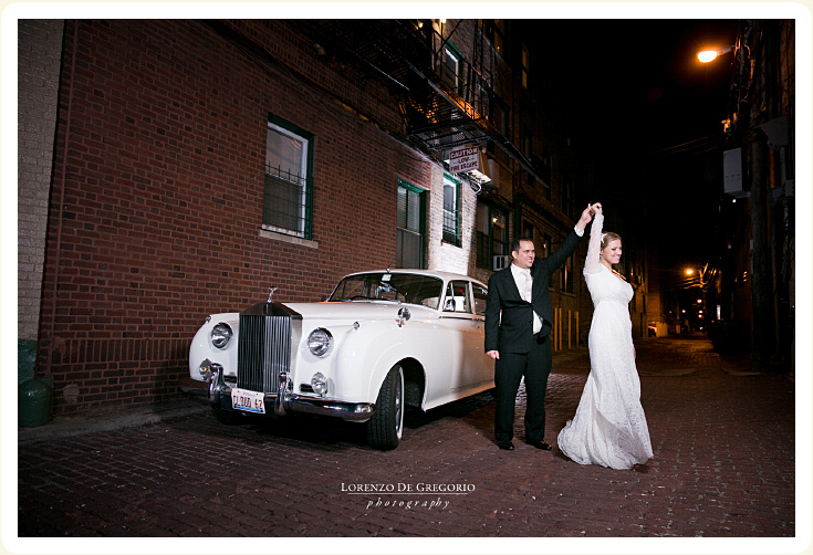 Post Reception rental car photo showing bride and Groom dancing by their 1962 1962 Rolls Royce Silver Cloud Classic Wedding car