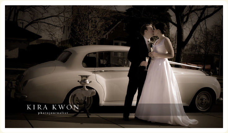Bride & Groom enjoy a champaign toast in the Classic Wedding Car